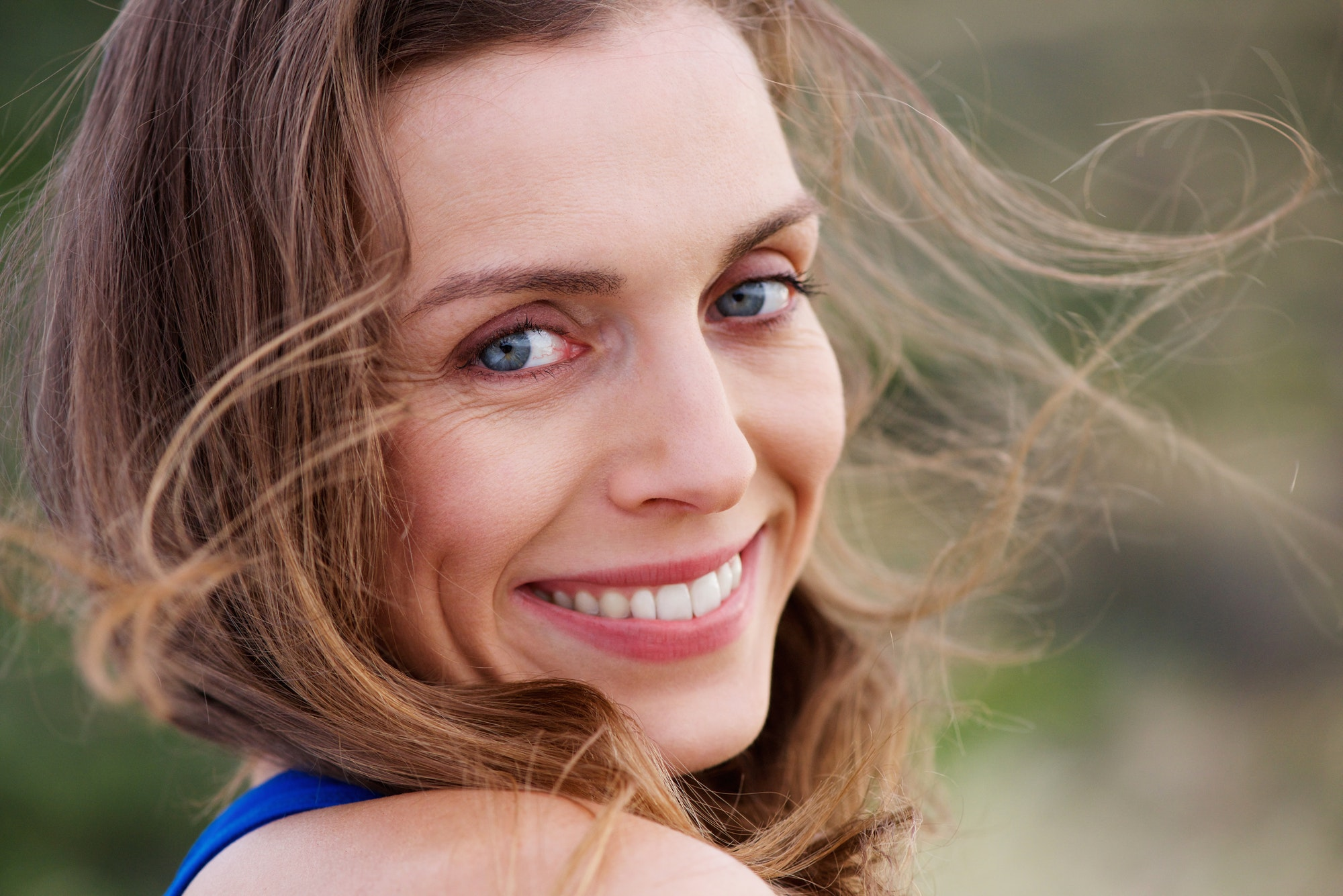 Healthy smiling woman outside